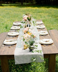 Masculine meets feminine in this tablescape from our #SWV5 A Southern Gentleman editorial. We daresay both the bride and groom would love how the silver trophy cups, peachy blooms, and pear accents look against the wood of the farm table! Link in profile to see more. By @StephenDeVriesPhoto, styling by @GinnyAu, florals by Lillie's.