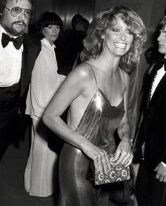 "1970s: Farrah Fawcett's chain-mail dress. Late-1970s ""disco chic"" was captured in the chain-mail slip dress Farrah Fawcett wore to the 1978 Academy Awards."