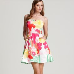 $70 ️️ shipped. NWT Lilly Pulitzer dress Beautiful strapless sundress. NWT Pockets in the side super flattering with ruffle detail along the top, hits about 1.5/2 inches above the knee Lilly Pulitzer Dresses