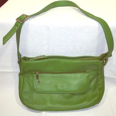 Stone & Co. Green Leather Shoulder Bag NWOT This Stone & Co. shoulder bag is a lovely spring green color. It is soft, plush, leather with steel detailing. The strap is adjustable. This bag is new and has not been used but does not have its tags. Stone & Co. Bags Shoulder Bags
