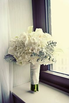 White hydrangea, white mini calla, stephanotis and dusty miller. Heather Saunders Photography