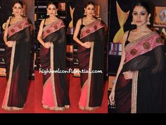 In a Manish Malhotra sari, Anushka attended the Star Guild Awards with severely pulled back hair, teeny bindi, the dramatic eyes and lust-worthy jhumkis.