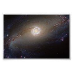 Barred Spiral Galaxy NGC 1097 Space Posters  from The Astronomy Gift Shop on Zazzle. This space image is also available on many other products. Image is from NASA - see product page for detailed image credit.
