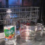 Remove hard water deposits/scale by running one cycle of your dishwasher empty, with distilled white vinegar. Do this after you've done the other cleaning steps, so that it will also take care of anything you missed during cleaning. Add 2 cups of vinegar to the bottom and turn the machine on to an energy saving or low wash. Stop the machine mid-wash, so the vinegar can set on the bottom and work.