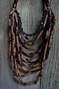 Handmade paperbead necklaces combined with wood, acrylic, silver, and bronze beads creating a beautiful statement, artistic, unique necklace by thepaperbeadery on Etsy https://www.etsy.com/listing/528203373/handmade-paperbead-necklaces-combined