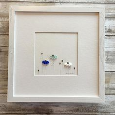 Pebble Art by Sharon Nowlan You can chose if youd like to purchase this just matted or matted and framed in the dark rustic frame or more modern simple black that you see in the photos. When purchasing this picture framed it will include a professional frame, mat and glass, a finished back