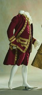 18th Century roughly 1760's men's waistcoat. This picture shows the waistcoat, coat, and breeches of the time. This particular item was made from wine red wool (coat) also being decorated in gold buttons, thread, and a gold braid. Found at the Kyoto Costume Institute.