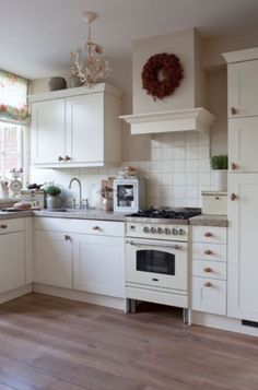 "Hmm.  Simple.  But wider.   *** This kitchen is from our feature ""Tale of Treasures"""