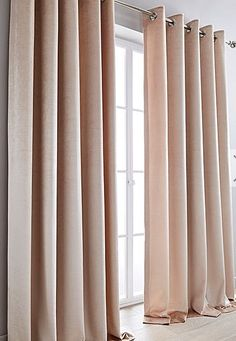 The Memphis textured velvet eyelet curtain will brighten and freshen any room. Matching pillow also available.