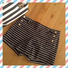 Navy/White Nautical Striped Shorts. So cute and fun to wear anywhere!  Gold anchor accent buttons on both sides, the stripes  look like nautical rope or chain.  Shorts have a flattering flat front look and button up on either side with two back pockets. Size 2,  cotton, spandex. Worn just a few times, like new condition. Price is firm. Kenar Shorts