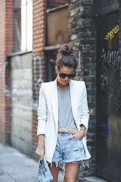 This is such a perfect spring look. White blazer and that belt makes the casual look more chic. I love a shorts and jacket combo. Street style inspiration!