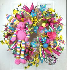 Image from http://southerncharmwreaths.com/blog/wp-content/uploads/2014/03/deco-mesh-bunny-wreath-turqoise-pink-yellow-1.jpg.