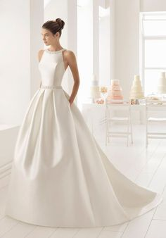 Classic-style beaded mikado wedding dress with halter neckline. Classic-style beaded mikado wedding dress with halter neckline. Boho Wedding Dress With Sleeves, Fairy Wedding Dress, Sheath Wedding Gown, Western Wedding Dresses, Classic Wedding Dress, Sexy Wedding Dresses, Bridal Dresses, Wedding Gowns, Timeless Wedding Dresses