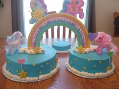 My Little Pony Cake - 8 and 10 inch cakes done in buttercream frosting and fondant accents.  The ponies are plastic.  I got the idea from one of the Wilton idea books. TFL!