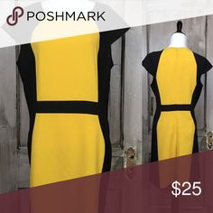 "Black and Gold Dress Nice lightweight color block dress with cap sleeves and back zip nwt. Size 14 41"" Waist 38"" Hip 41"" Length 39"" 88% Polyester 9% Rayon 3% Spandex Machine Wash Cold Line Dry. voir voir Dresses Midi"