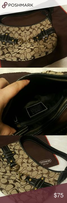 | coach | handbag | Authentic Coach handbag. Measures approx 11 across and 7 tall. About a 7 inch handle drop. Black leather trim. Comes with dust bag. One zip compartment on inside. Coach Bags