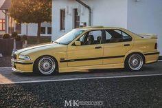 Dakar yellow BMW e36 sedan on OEM BMW Styling 5 (BBS RC) wheels