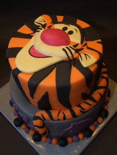 Tigger cake (i love tigger! maybe skip having his face on it, but i love the stripes on the top tier and the tail wrapped around)