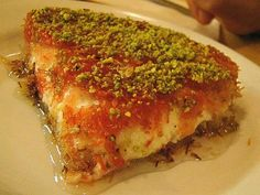 This is arguably the most famous Middle Eastern dessert. Typically, this dessert is a sweet cheese topped with one of two types of crust-like topping. Then it is topped with pistachios and smothered in a sweet sugar syrup. Middle East Food, Middle Eastern Desserts, Middle Eastern Dishes, Arabic Dessert, Arabic Sweets, Arabic Food, Armenian Recipes, Lebanese Recipes, Knafeh Recipe Lebanese