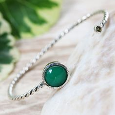 Green onyx and tiny tourmaline gemstones cuff bracelet with sterling silver twist band design