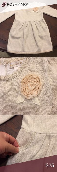 Maggie & Zoe Sweater Dress Gold flecked off white sweater dress with real working pockets to keep little sweeties hands warm this winter! Chiffon Rosebud detail on chest has some snags but not noticeable unless you are looking at it from 12inches away or closer! Still an amazing buy if you don't take it from my closet this winter my little girl will be getting it for sure!!!! MAGGIE & ZOE Dresses