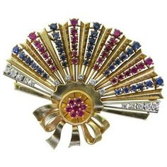 Retro 18k gold fan brooch decorated with sapphires,rubies and diamonds. Brooch has a hinged bale so it can also be worn as a pendant. DESIGNER: Not Signed MATERIAL: 18K Gold GEMSTONE: Diamond, Sapphir