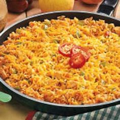 Mexican Chicken and Rice Recipe -On days I get home late from the hospital, I'm glad this main dish comes together easily in one skillet. Sometimes, I make it ahead in the morning and refrigerate. It's so quick to just sprinkle on the cheese and reheat it for dinner.—Cindy Gage, Blair, Nebraska