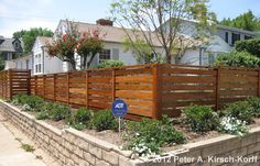 A Santa Monica fence builder's photo of a custom horizontal style contemporary wood fence. See over photos of my fine wood fences, gates and more. Serving the Santa Monica and Los Angeles area and building beautiful, custom wooden fences. Brick Fence, Front Yard Fence, Cedar Fence, Fenced In Yard, Wood Fences, Concrete Fence, Bamboo Fence, Fencing, Modern Fence