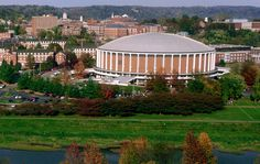 CONVOCATION CENTER - Located in the Athletic Mall. The Convocation Center, located on West Green, houses Ohio University Bobcat basketball, volleyball, and wrestling matches, and offices for Intercollegiate Athletics, including the baseball, basketball, cross country, field hockey, golf, soccer, softball, track, volleyball, and wrestling programs, and part of the School of Electrical Engineering and Computer Science. It is also a residence hall. HISTORY of the BUILDING -  The Convocation…
