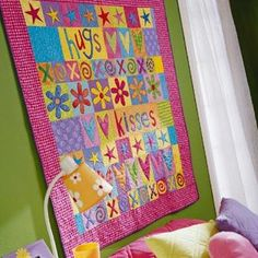 Bright Hearts and Flowers  Fusible web makes this appliqué project fast and easy to complete. Choose vibrant colors and sassy prints to ma...