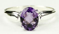SR058, 9x7mm Amethyst, 925 Sterling Silver Ring  * Stone Type - Mystic Fire Topaz  * Approximate Stone Size - 9x7mm * Approximate Stone Weight - 2.3 ct * Jewelry Metal - Solid .925 Sterling Silver * Approximate Metal Weight - 2.4 grams * Ring Size - Size selectable during checkout  * Our Warranty - A full year on workmanship  * Our Guarantee - Totally unconditional 30 day guarantee