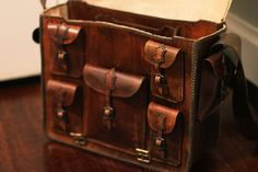 """Dimensions: 15"""" wide 12"""" high 6"""" deep Leather Travelers Bag by RCSmithLeatherworks on Etsy...price unknown"""