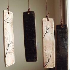 northern lights = hand-cut white porcelain clay + leaf impressions + iron oxide wash + glazes + hemp cord + oak branch & lichens