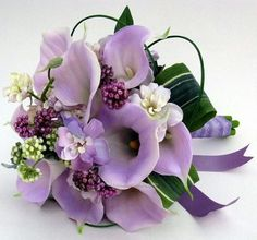 My bouquet will be different shades of purple, Black & White Calla Lillie's with Pearl and Butterfly accessories:)