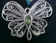 handcrafted sterling silver filigree butterfly with peridot