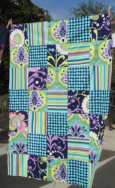 amy butler's fabric ` love the same color pallet with super contrasting fabrics. :)
