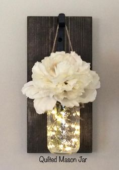 This listing is for a gorgeous and unique Rustic Lighted Mason Jar Sconce! This set can be purchased as a single or set of 2 sconces. Lights and Flowers come with this purchase!! This listing shows Ball Quilted Mason Jars. These gives a beautiful look when lights are on:) You can