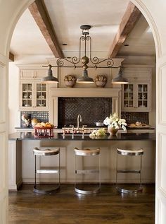 Love this kitchen....light fixture, gray cabinets, wood beams on ceiling...such a classy cozy feel!  NINE + SIXTEEN