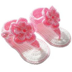 Belle Sandal - These cozy sandals are a must have for your baby girl! An adorable pink crocheted flower adorns the toe thong for an extra girly feel. A shimmery jeweled button serves as a closure for the comfy pink crocheted ankle straps. The soles feature a white knit, with cute pink stitching accents. Baby is going to look fab in these sandals as she shows off those tiny tootsies!