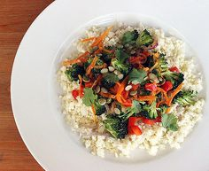 """Cauliflower """"Rice"""" Stir-Fry: Don't become victim to that late-afternoon, post-takeout slump. This paleo-friendly cauliflower """"rice"""" stir-fry"""" recipe satisfies your greasiest cravings with fresh produce atop """"rice"""" made from cauliflower."""