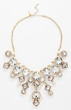 Free shipping and returns on kate spade new york 'palace gems' bib necklace at Nordstrom.com. Mirror backings amplify the sparkle of each faceted crystal in a kinetic statement necklace while teeny champagne-tone faux pearls tie together the regal look by complementing the warm-gold plating.