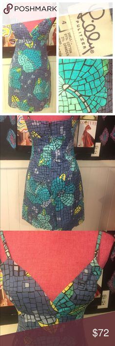 "Unique Lilly Pulitzer sz4  DRESS❤️❤️ Unique Lilly Pulitzer size 4 dress.  Has a little stretch.  Chest is 32"" waist is 26"" hips are 38"". The colors are fab.  Either mosaic looking or stain glass.  Or I'm seeing things...great summer dress/vaca❤️ Lilly Pulitzer Dresses"