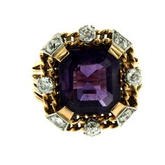 Amethyst Diamond Gold Ring.   A beautiful natural 5.62 carats Amethyst of rich color set in rose and white 18k Gold in an exquisite Cocktail Ring. The center stone is surrounded by 8 round-cut Diamonds totaling approximately 0.90 carat. This piece is designed and crafted entirely by hand. Circa 1940.  €2,300.00