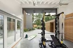 Build an awesome home gym with these inspirational garage gym ideas gallery we have put together. Find the perfect gym equipment for your garage. Garage Gym, Basement Gym, Small Garage, Garage Walls, Gym Interior, Modern Interior Design, Modern Interiors, Armoire Garage, Home Gym Decor