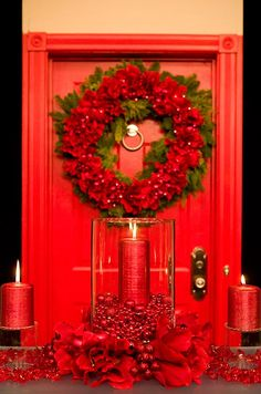 For more traditional holiday decor, pair fresh holiday greens and large red flowers with red beads, ornaments and pillar candles.
