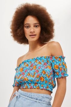 In a bright floral print on a vibrant blue base, this gypsy crop top is great for warm weather. It comes in traditional shirred fabric and flattering off-the-shoulder style. Team with a high-waisted skirt and platform sandals for sunny days.