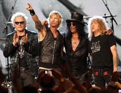 Inductees Izzy Stradlin, Matt Sorum, Duff McKagan, Slash and Steven Adler of Guns N' Roses, perform onstage during the 27th Annual Rock And Roll Hall Of Fame Induction Ceremony on April 14, 2012 in Cleveland, Ohio.