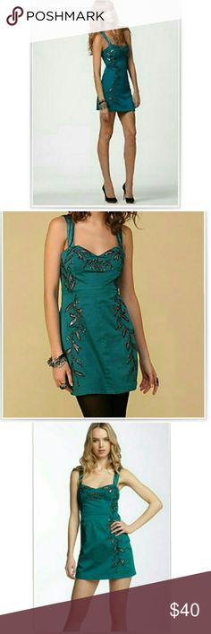 💕Free People💕 💕NWOT- Excellent condition Leaf Motif halter dress Color: Teal/jade Stretchy back panel Side zipper Black/ silver embroidery   💕Material: 97% Cotton; 3% Spandex   💕Price Firm🦄🦄 Free People Dresses