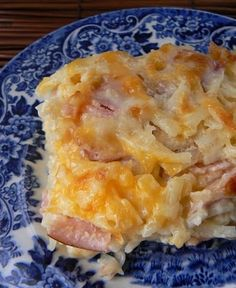 "30oz bag frozen, shredded hash browns  8oz sour cream  1 can cream of chicken soup   1/2c melted butter  1 small onion, diced fine  16oz cubed ham   2c shredded cheddar, set aside 1c  Stir all the ingredients together. Place into a lightly greased 9x13"". Sprinkle top w/1c cheese. Bake at 350F for 45 min - 1 hour. Let cool a bit and serve."