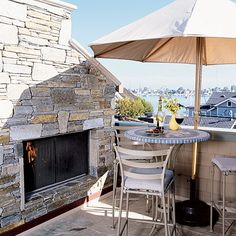 Umbrella-Covered Patio - Style Your Outdoor Hearth With These Hot Looks - Coastal Living